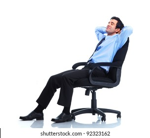 Relaxing handsome businessman. Isolated over white background.