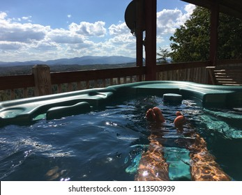 Relaxing in hot tub on balcony overlooking Mountain View