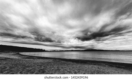 Relaxing image of beautiful beach and ocean landscape. Black and white. High Coast, Stora Sand, Sweden.