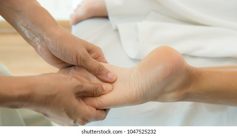 Relaxing massage on the foot in spa salon â?? indoors, Woman receiving a foot massage at the health spa,
