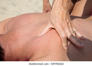 Relaxing massage on the sand of the hotel's beach during the summer holidays