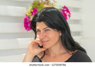 Relaxing moment of a woman at a coffee store.