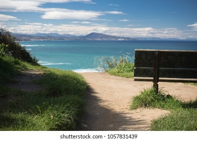 relaxing moments, close up of bench with panoramic view on atlantic ocean, bidart, france