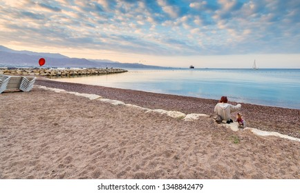 Relaxing morning on central beach in Eilat - famous tourist resort and suitable for perfect vacations and holidays city