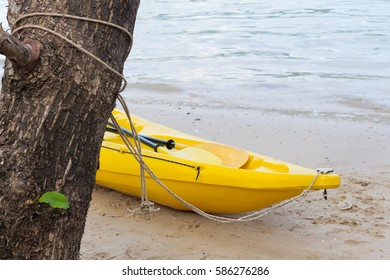 Relaxing on beach with kayak
