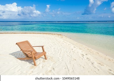Relaxing on chair - Belize Cayes - Small tropical island at Barrier Reef with paradise beach - known for diving, snorkeling and relaxing vacations - Caribbean Sea, Belize, Central America