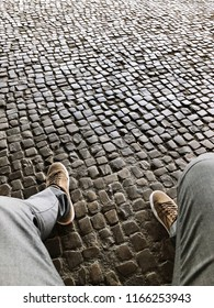 Relaxing on the cobblestones.