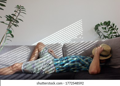 Relaxing on couch at home while summer heat