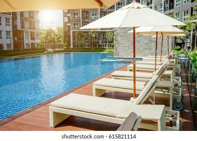Relaxing Pool Bed Beside Swimming Pool