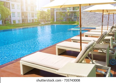 Relaxing pool bed beside swimming pool