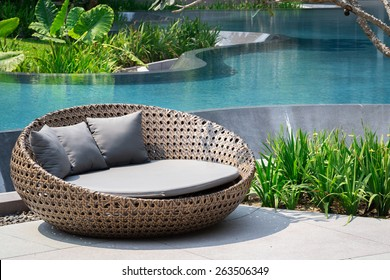 Relaxing Rattan Sofa At Swimming Pool