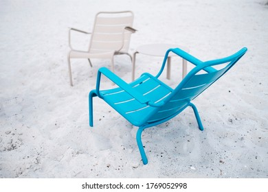 Relaxing in the sand dunes in a nice chair
