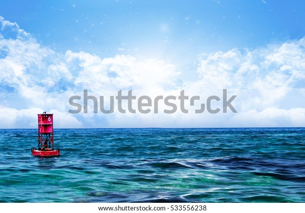 Relaxing Sea water and sky with Floating Red Buoy