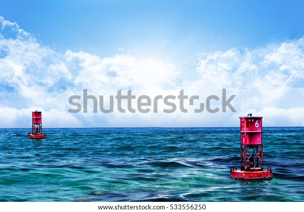 Relaxing Sea water and sky with Floating 2 Red Buoy