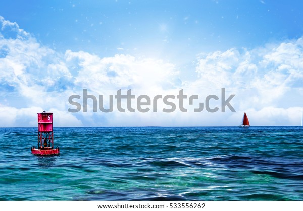 Relaxing Sea water and sky with Floating Red Buoy with solo sealing boat