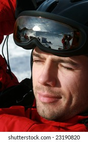 Relaxing skier with wearing goggles, close-up.