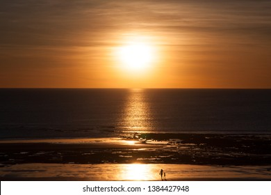 A relaxing sunset, contemplating nature, sun setting on the ocean, cable beach, Broome, Australia