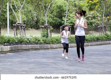 Relaxing time on summer,Daughter and mother jogging at park