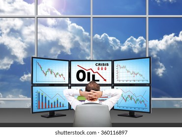 relaxing trader looking on four screens with statistics fall in oil prices