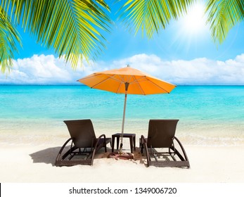 Relaxing under a sunshade with beach chairs