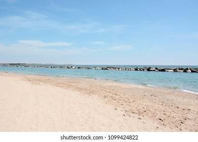 A relaxing view of Toronto Centre Island Beach and Lake Ontario on a beautiful sunny day.