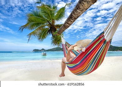 relaxing Woman in a hammock on a tropical beach