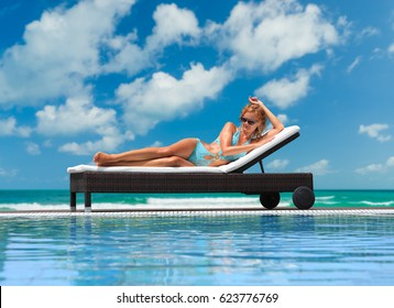 Relaxing woman in luxury hotel pool on holidays vacation travel.