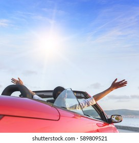 Relaxing woman on the beach in the car without a roof. Vacation, holiday, journey to the sea or the resort.
