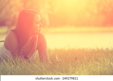 Relaxing woman on grass - Shutterstock ID 249279811