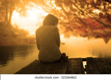 Relaxing woman in sunset