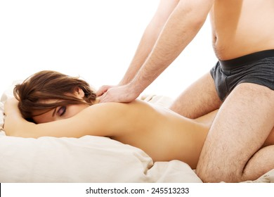 Relaxing young couple making massage at home.