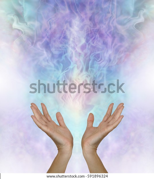 Release and let go - female hands reaching up and out towards a  gaseous field of ectoplasmic matter on a turquoise blue purple background with copy space