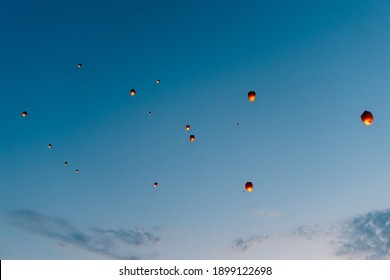 releasing flying lanterns at dusk