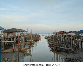 the relection of the firshermen's boats near a jetty at tanjung Piai, serkat Johor.