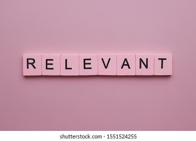 Relevant word wooden cubes on pink background