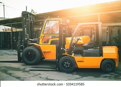 Reliable heavy loader, forklift truck. Heavy duty equipment background