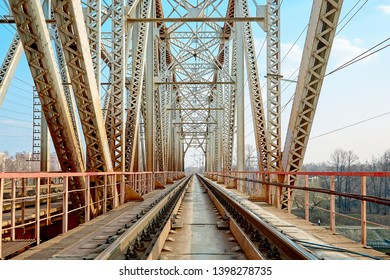 Reliable railway bridge, against the backdrop of beautiful nature and blue sky. Looking through the bridge. Backgound