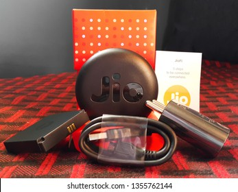 Reliance Jio JioFi Mobile Wifi Hotspot  unboxed - shown are the device and the accessories along with the user manual [Chennai, TN, India - March 12, 2019]