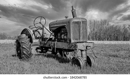 A relic tractor rusting in a field.