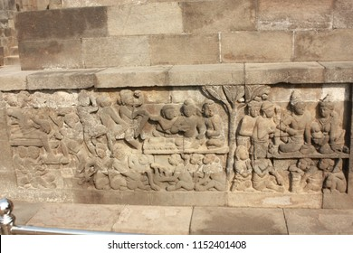 "Relief carving on the lower part of Borobudur Temple showing stories related to ""Kamadhatu"", the lowest level of human lust."