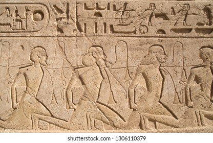 Relief depicting a row of captives in the Abu Simbel temple of Ramesses II, Egypt