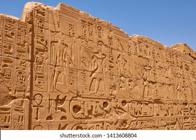 Relief details and Egyptian hieroglyphs at Karnak temple complex and Karnak Open Air Museum (about 1250 BC), Luxor, Egypt