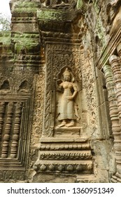 Relief of devata at Ta Prohm. Ta Prohm, the temple at Angkor, Siem Reap, Cambodia. The photogenic place because trees are growing out of the ruins.