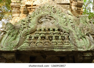 Relief on stone at Ta Prohm. Ta Prohm, the temple at Angkor, Siem Reap, Cambodia. The photogenic place because trees are growing out of the ruins.