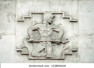 Relief of the Roman god of fire Vulcan.  On the facade of the 1930's building which once house the headquarters of the British Iron and Steel Federation in London.