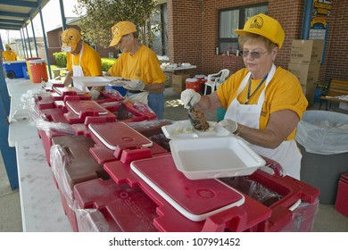Relief workers from Red Cross offering food to weary after Hurricane Ivan hit Pensacola Florida