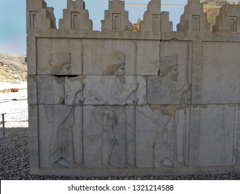 Reliefs of marching Median and Persian guardians, decorating the walls of royal palace Apadana in Persepolis, ancient capitol of Persia. Museum located near Shiraz in Iran