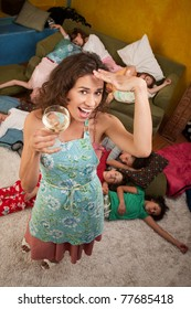 Relieved babysitter enjoys a drink while the kids are asleep