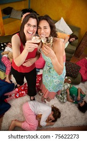 Relieved mom and babysitter drinking alcohol after kids go to sleep