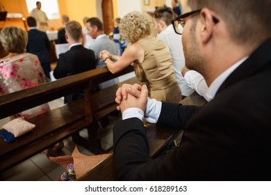 Religion concept. People praying in church